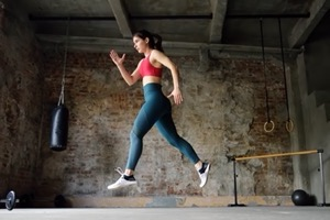 Sporty woman during hiit workout sportswoman jumpi DQRUAJ8