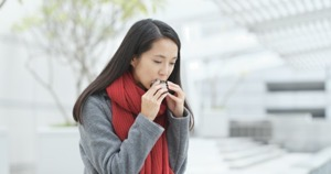 Woman eating japanese rice cake B8NYDJF
