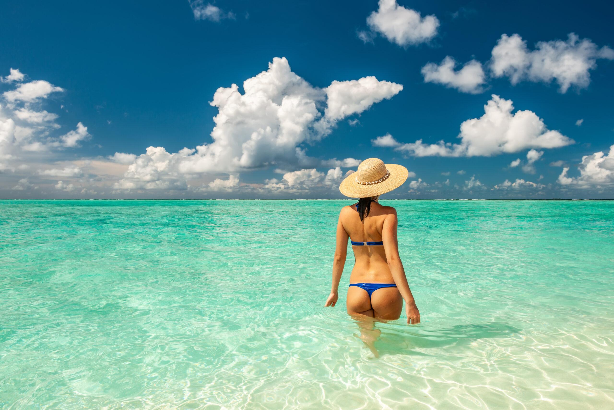 Woman in bikini at beach in maldives PB3VQY2